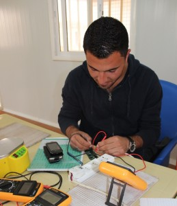 Basel Noserat learns to repair mobile phone at Za'atri refugee camp in Northern Jordan.