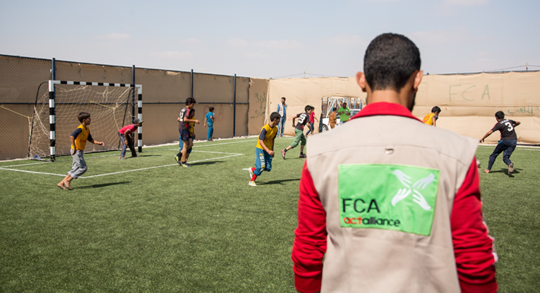 Football practice for young Syrian refugees at Za'atari camp in Jordan. Photo: Ville Asikainen