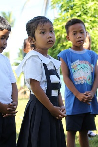 The school day starts with The Lord's Prayer, the National Anthem and flag raising. Gellian Maragrag has already learned these in Kinder (preschool).
