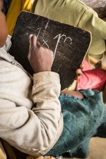 The end of the year exams are underway in the first grades of the school repaired by FCA. Today is the turn for the written exams on mathematics and French language. Most of the children do not have paper, so the exams are done on chalk boards.