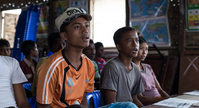 Before the conflict forced him to leave his home and work, Hla Tin (left) hadn't attended school at all and only worked. Now he dreams of working at the sea one day. Next to him is his friend and schoolmate, Ar Zarni Maung, 15.
