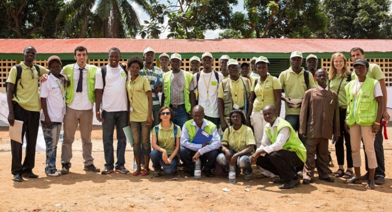 The staff of Finn Church Aid's Central African Republic office at the inaugration of Malimaka School in the capital Bangui on 19th August 2014. Nearly 5000 children and youth study at Malimaka School, which was repaired by FCA. In total 30 000 Central Africans go to schools repaired by FCA. Photo: Ville Asikainen