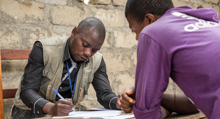 ETN employee David Ngabo taking registrations from new students at the Masisi education centre. Photo: Ville Asikainen.