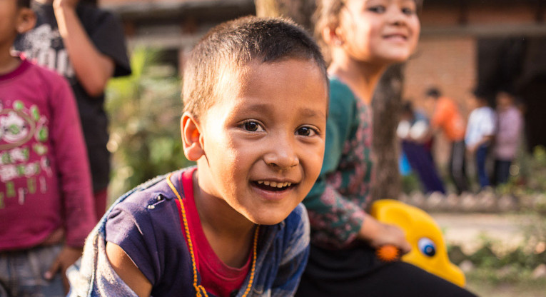 Play is a good way to help a child recover from trauma. Ritesh Khadka seems to enjoy posing for pictures as much as playing with friends. Photo: Antti Helin