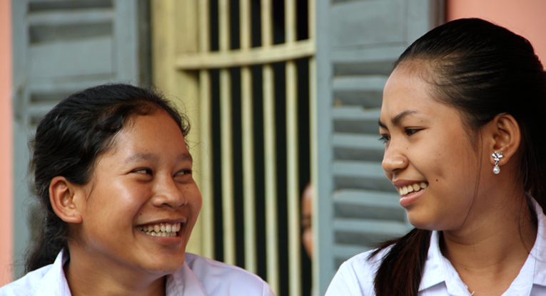 Lan Davin (left), 18, teaches English on the weekends to the children in her home town. Davin dreams of becoming a doctor or a teacher. For 16-year-old Prin Kaya (right), physics and chemistry are the favourite school subjects.