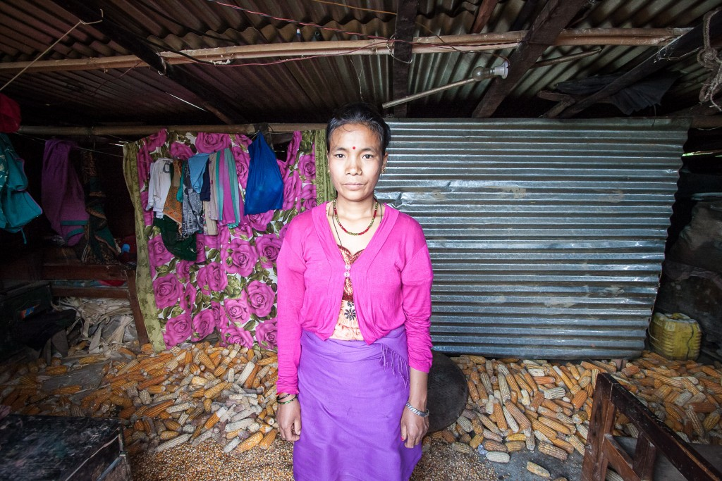 Sangita Thing is drying her corn crop on the floor of her home because there is no room anywhere else.