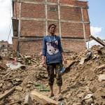 Nikisha Bhalandyu stood on the ruins of her former home in Bhaktabur in the Kathmandu Valley in April 2015. Photo: Antti Helin