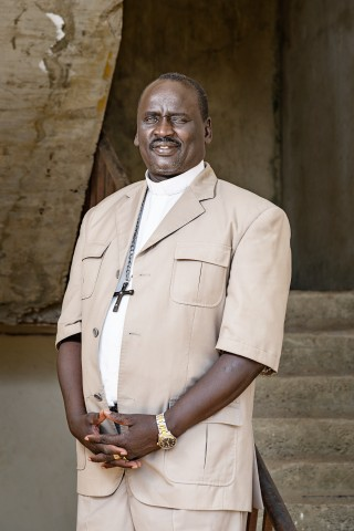 Bishop Isalah Majuk Dau was 10 years old when he had to escape the fights for his life and 17 years old when he got to start school. Now he is building peace to South Sudan. Photo: Ville Palonen