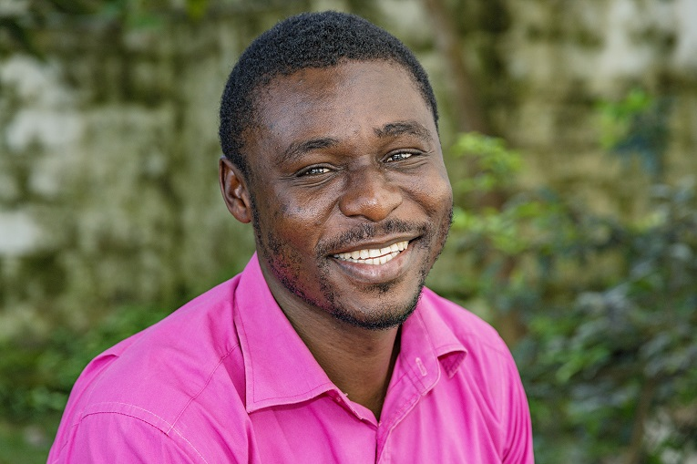 """Liberian Claudius Blamoh has come a long way from the streets of the slums to an FCA Finance Officer. In his life, he has found encouragement from Romans 8:28 """"And we know that in all things God works for the good of those who love him, who have been called according to his purpose."""""""