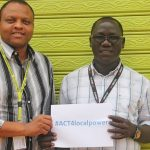 """Omodii Alex Gupirii from Christian Aid (right) and Edison Munene from Finn Church Aid with the ACT Consortium hashtag for the new program.  """"The ACT Forum-South Sudan welcomes the Capacity Building Program because an institution with capacity is one which is able to meet the needs of the people it serves."""" Photo: Kaisa Honkala, FCA"""