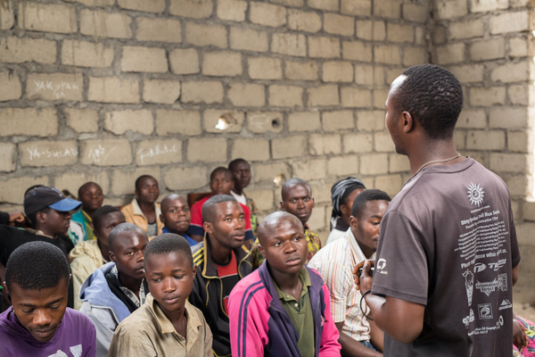 Former child soldier Heritier Nguma telling students about his life story in Masisi, Democatric Republic of Congo. Photo: Ville Asikainen