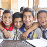 Shortly after the 2015 earthquakes in Nepal, FCA built 170 safe, temporary learning spaces to affected areas and provided teacher training and learning materials. From the right, Santash Paniyar, Bipin Khatri, Sakar Karki, Gopal Basnet and Nabin Kumar Moktan are enjoying their bamboo school in built by FCA in Kathmandu. Photo: Antti Helin.