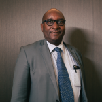 Ugandan pakolaiskomissaari David Apollo Kazungu.