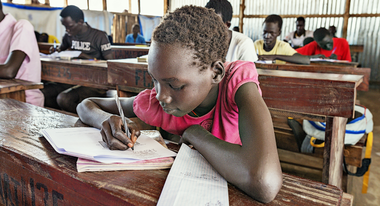 Achuri David Panjir studies in Mingkaman, South Sudan. A total of 132 000 children and youth gained from FCA's education projects in 2016 and 4 693 teachers took part in trainings that were arranged in program countries.