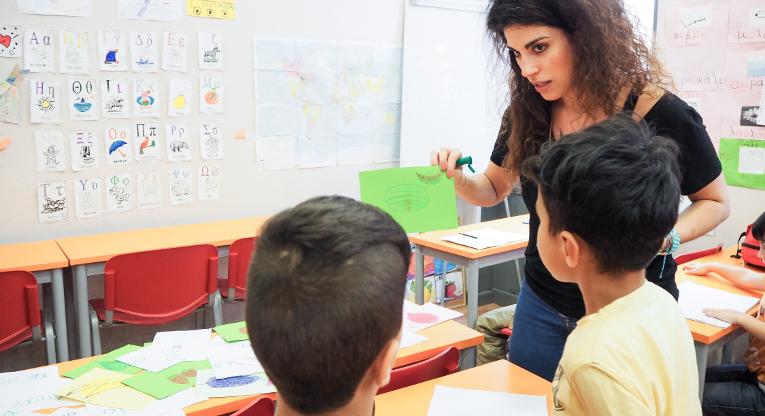 Natassa Tseliou teaches refugee children the basics of Greek.