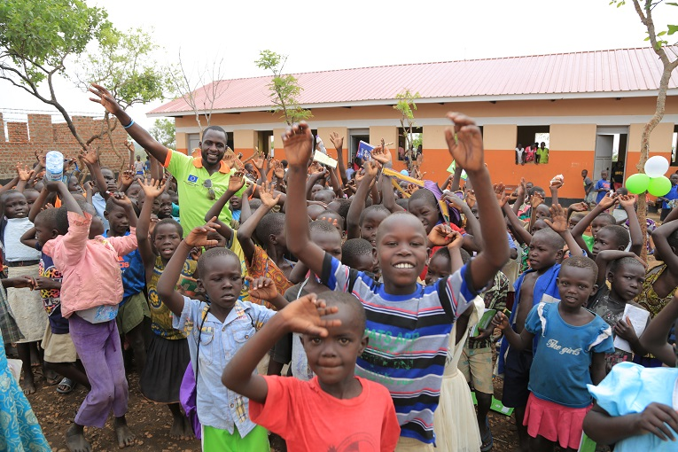 Children celebrate at the school handover ceremony.