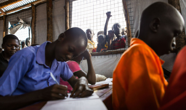 Children learning at a refugee camp in Uganda at FCA's temporary school