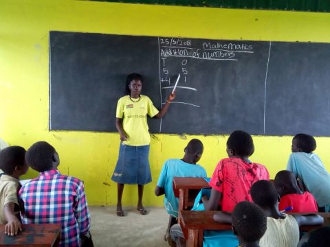 Stella Boyoi teaches mathematics to children in the newly built classroom. Photo: Kajasuk Jackson