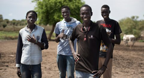 Bollein Daki (in front) and his friends from the Kurenen age-set are able to move freely in the town of Pibor after the peace process. Before the peace, they were engaged in bloody fighting against other age-sets and were forced to hide out of town. Photo: Hugh Rutherford.