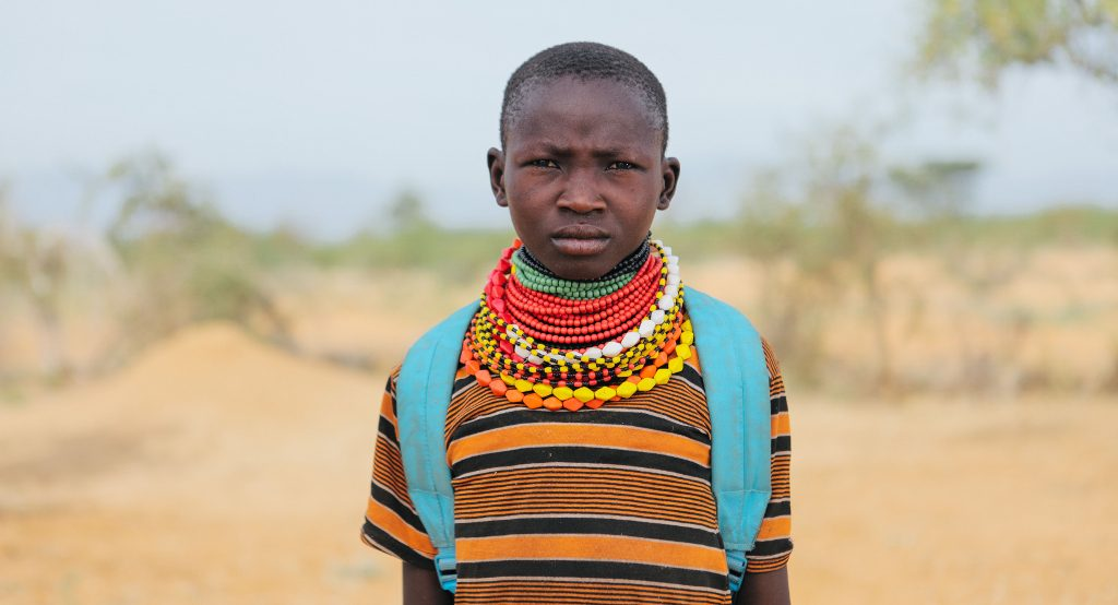 Rebecca Atubo, 12, säger sig tycka bättre om skolan än om att valla djur. Hennes favoritämnen är engelska och matematik. Foto: Tatu Blomqvist/Kyrkans Utlandshjälp