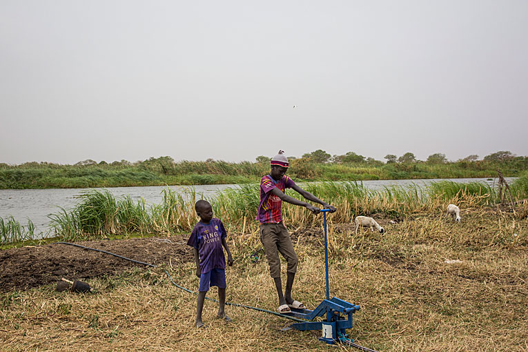 The water pump has caught the interest of the youngest South Sudanese children in the village.