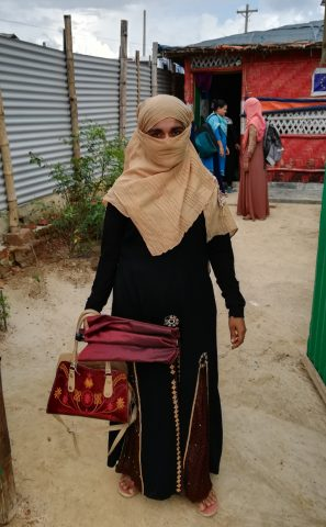 Fatima leaving the Women and Girls safe space to go home to her 3 year old son.
