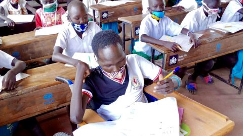 Simon Peter has returned to class after schools gradually reopened in Kenya's refugee settlements. Photo: Finn Church Aid