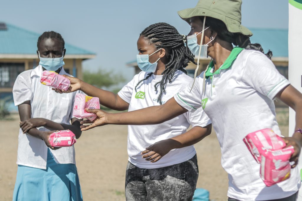 Catherine Angewenyi from FCA distributing sanitary pads at Kalobeyei refugee settlement.