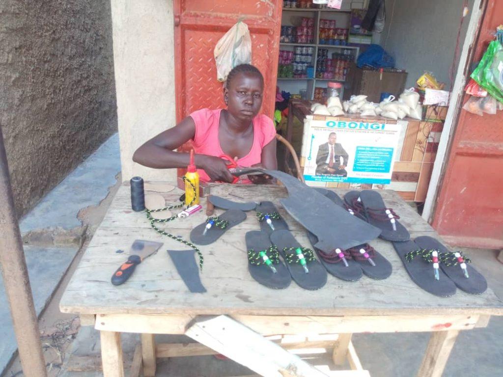 Esther Kuyang making sandals in her workshop.